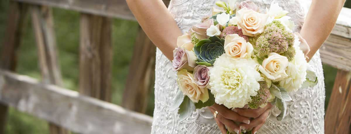 Beautiful wedding boquet with jewlery and antique dress detail