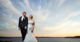 Bride and Groom pose in stunning sunset