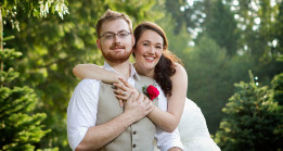 Bride and Groom snuggle under pine tree at Trinity Tree Farm in Issaquah, Washington